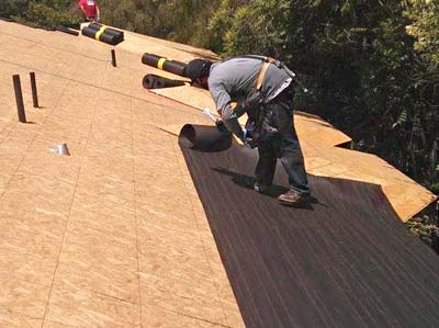 Roofer in Santa Clara installing membrane roofing