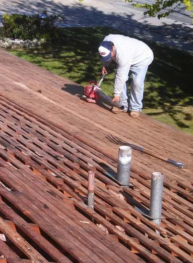 one of our roofers in Milpitas is removing old shingles