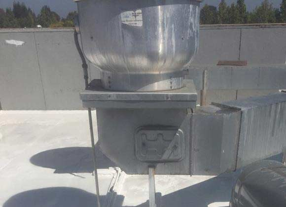 commercial roof installation with ductwork and venting
