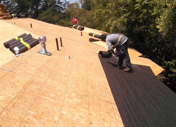 roofer in Morgan Hill installing waterproof membrane
