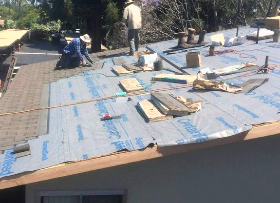 the team working on a roof repair in Palo Alto