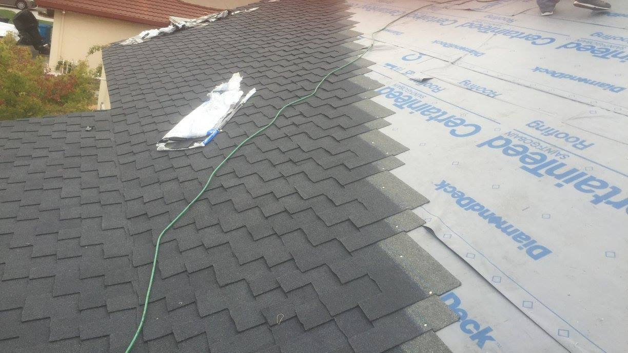 asphalt shingles being added to a residential roof during a reroofing in sunnyvale