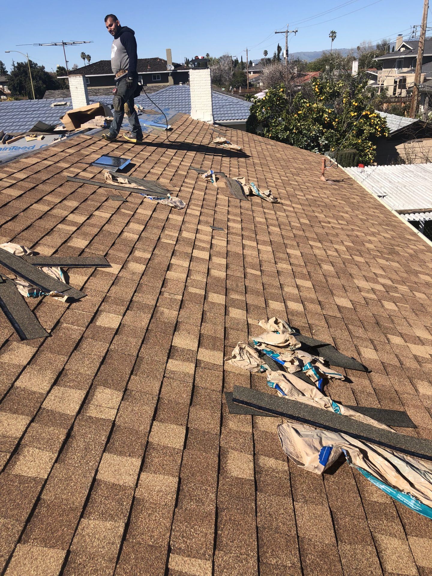 roof repairs being done on a residential roof in morgan hill