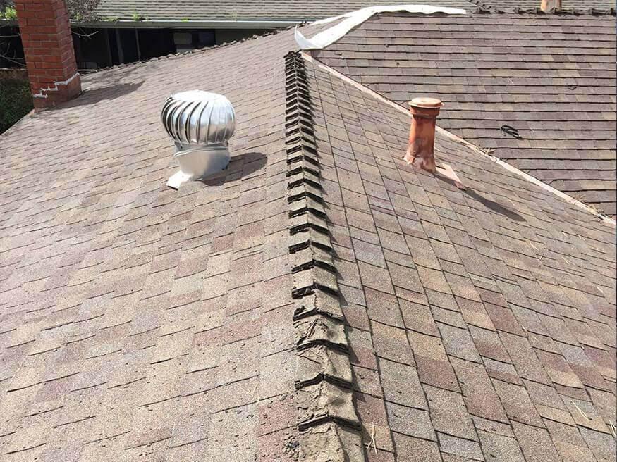 repairing an asphalt shingle roof with a damaged ridge