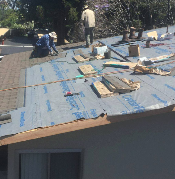 our team working on a residential roof repair in Saratoga